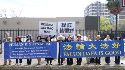 Practitioners hold a press conference in front of the Chinese Consulate in Houston, Texas.