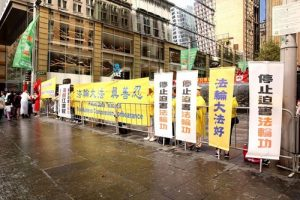 Falun Gong practitioners hold banners during their peaceful protest at Martin Place in Sydney, Australia.