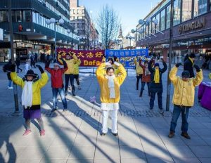 Falun Gong practitioners demonstrate the exercises at the downtown square in Södertälje, Sweden.