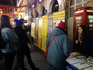 Tilly (on the right) talks to tourists about the persecution in China during the 2017 Chinese New Year.