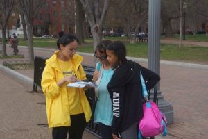 Falun Gong practitioners talk to people passing by about the persecution taking place in China.