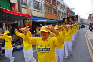 Falun Gong practitioners demonstrate the exercises during the parade.