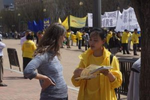 Falun Gong practitioners talk to passersby near the White House about the persecution taking place in China.