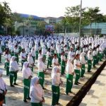 Teachers and students at Kartini High School learn the Falun Gong exercises.