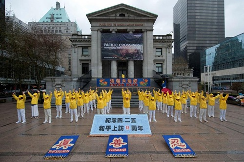 Group exercises in downtown Vancouver on April 22, 2017.