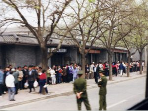 Falun Gong practitioners standing on the sidewalk at the west side of Fuyou Street, Zhongnanhai, Beijing.