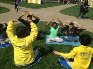Learning the Falun Gong sitting meditation exercise at Purdue University's Spring Fest.
