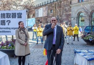 Dr. Harold King offers his support at the rally in Sweden.