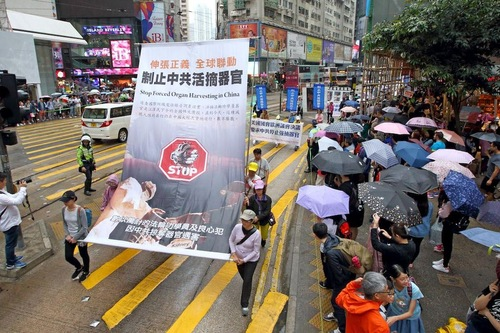 "Banner in Hong Kong march reads ""Stop Forced Organ Harvesting in China""."