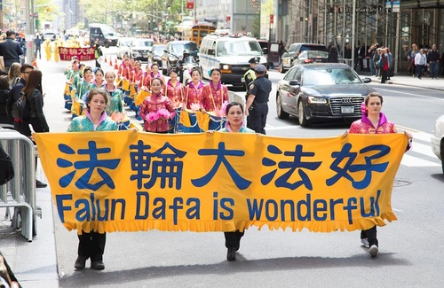Practitioners from different cultures held a march in New York City on May 12 to celebrate the 18th annual World Falun Dafa Day.