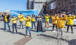 Demonstrating Falun Gong exercises at Mynttorget, outside the parliament building.