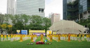 Practitioners do the exercises together in Hong Lim Park on May 2 to celebrate World Falun Dafa Day.