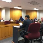 Dr. Sa Geng (left) shares his witness testimony at the Homeland Security Committee for HCR 7 on February 23.
