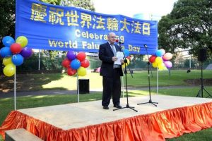 Andrew Wilson, former city council member for the City of Parramatta, participates in the rally to express his support for Falun Gong.