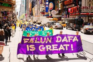 Practitioners from different cultures attended the march in New York City on May 12 to celebrate the 18th annual World Falun Dafa Day.