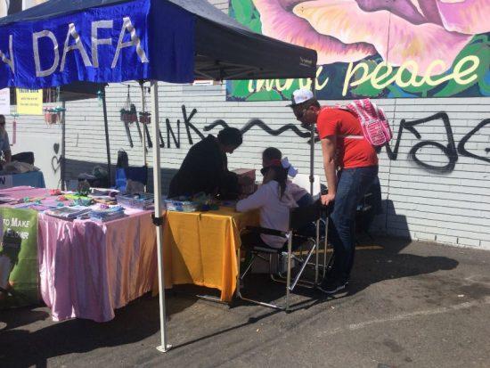 Lotus Flower making at the Falun Dafa stall.