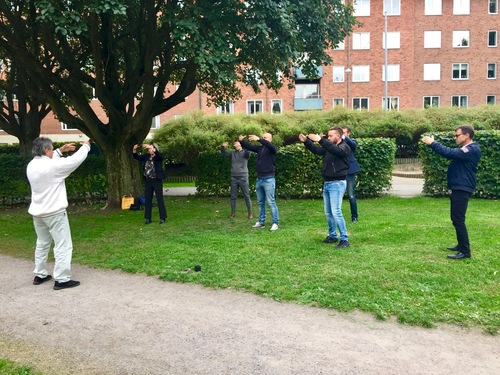 BNI members in Linköping, Sweden learning the Falun Dafa exercises.