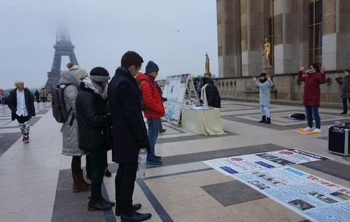 tourists read posters on human rights square