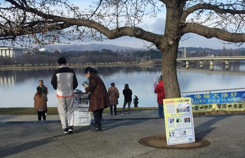 Falun Gong practitioners in Canberra raise awareness to Chinese tourists at Lake Burley Griffin in Canberra.