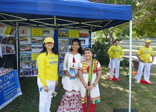 Visitors at the multicultural festival express their support for Falun Gong.