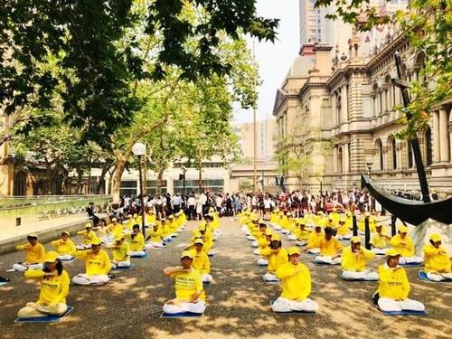 Practitioners demonstrated the sitting meditation exercise on Human Rights Day, Tuesday, December 10, 2019.