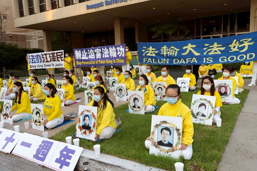 Falun Dafa practitioners held a candlelight vigil in front of the Chinese Consulate in Los Angeles on July 20, 2020.