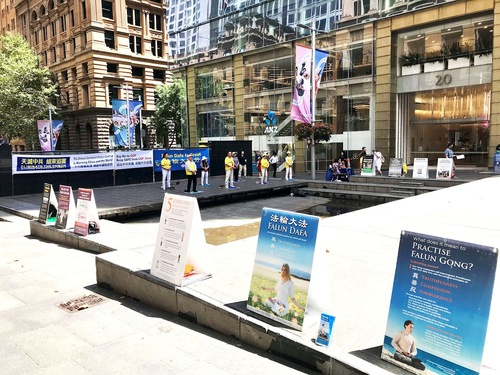 Falun Dafa practitioners in Sydney demonstrate the exercises and display information at Martin Place in the city's business and financial district.