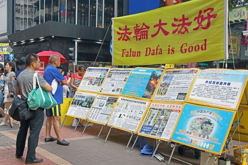 Practitioners fearlessly raise awareness on Hong Kong's streets.