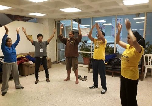 Learning the Falun Gong exercises in an earthquake shelter.