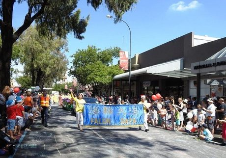 Falun Gong practitioners perform in the Christmas parade in Norwood, Adelaide.