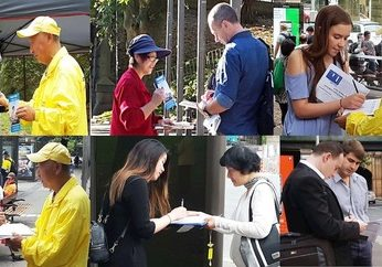 People read Falun Gong materials and sign the petition to support the practitioners' efforts.