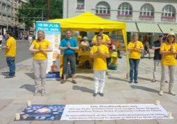 Demonstrating the Falun Gong exercises on Marktplatz in Karlsruhe.