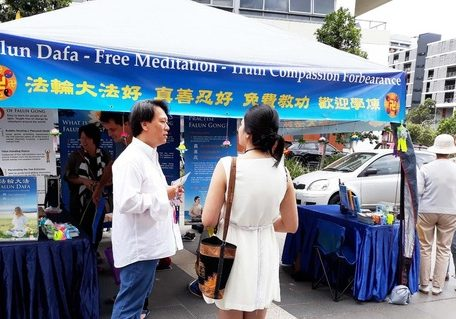 Telling market visitors about the persecution.