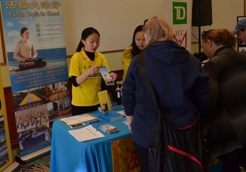 Falun Gong practitioners introduce the practice to visitors at the 16th International Day for the Elimination of Racial Discrimination held by the York Regional Police at the Markham Event Centre, Markham, Ontario.