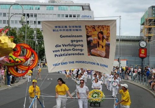 Falun Gong practitioners hold a march in Berlin on August 10, 2019 to raise awareness of the persecution in China.