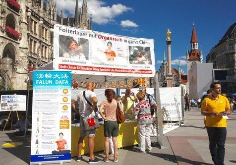 Falun Gong booth at Marienplatz in Munich, Germany, August 13